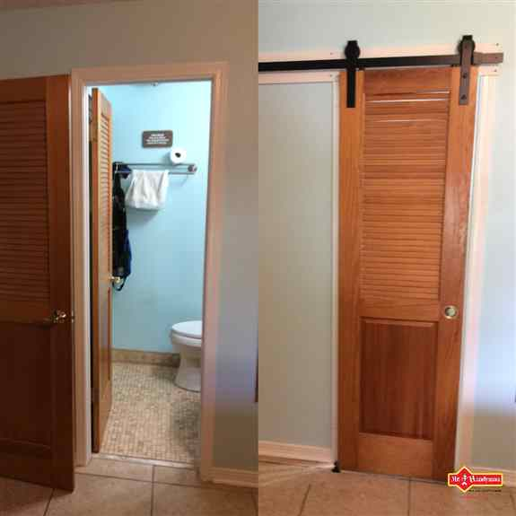 Barn doors are a great accent and way to improve the space in a bathroom where the door swung through the room to close.