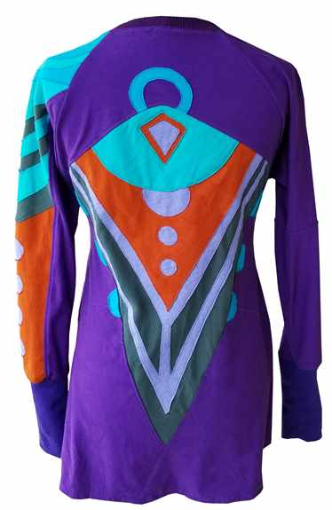 This is a one of a kind tunic, made using 100% recycled t-shirts. The Channel Tunic might the most comfy, epic tunic to come from Flood studios. Fitted through the arms and bust only, this tunic falls naturally from the bust into a flowing fit around the