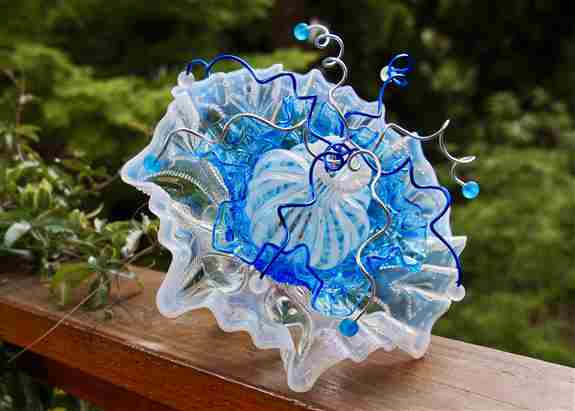 Vintage Westmoreland and Fenton MCM glass embellish this blue and white flower. A delicate hand blown vase and wirework topped off with vintage glass beads.