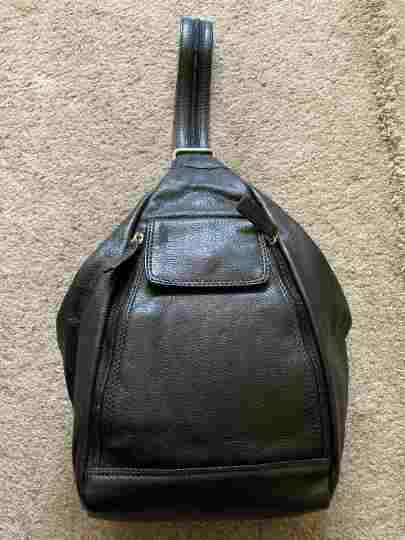 Duel purpose leather backpack, zipped strap.  Strap can be unzipped to use as backpack.Black
