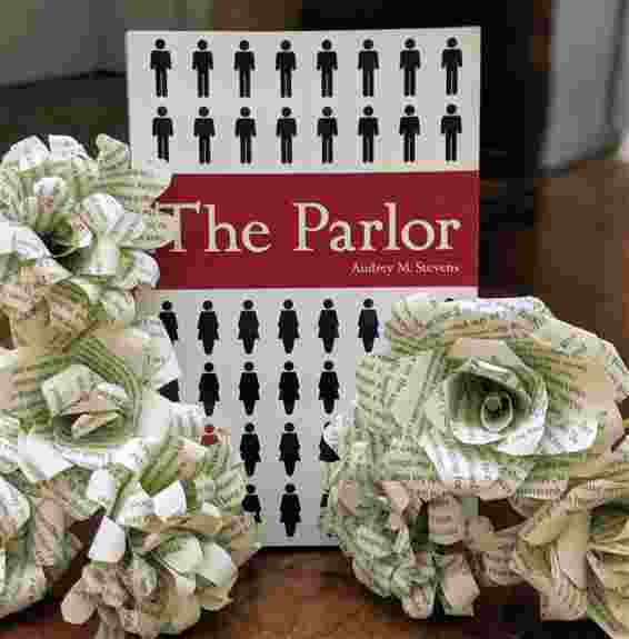Flowers made from book pages will for sale along with The Parlor series.