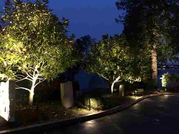 Lighting installation that highlights this lovely driveway entrance.
