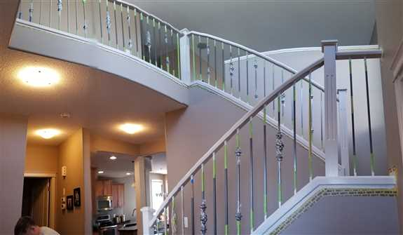 A Blonde Light Birch wood stairway changed color to a Realist Beige tone. House shows its glow which beautifully enhances the space.