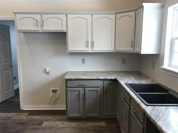 We take your cabinets and make them look modern and new again, without the cost and hassell.