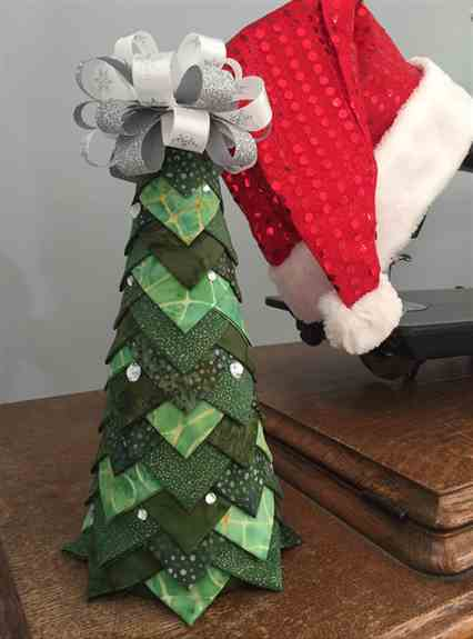 """Check out our """"Quilted Christmas Tree!""""  Comes in 4 different sizes!"""