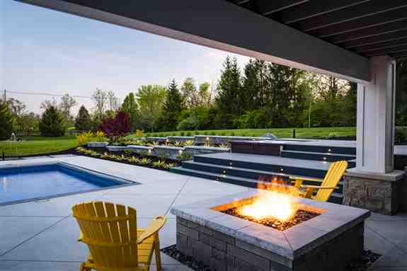 With a custom fire pit, you can enjoy the great outdoors well into the cool season. Nothing brings people together more than s'mores and the ambiance of a warm bonfire!