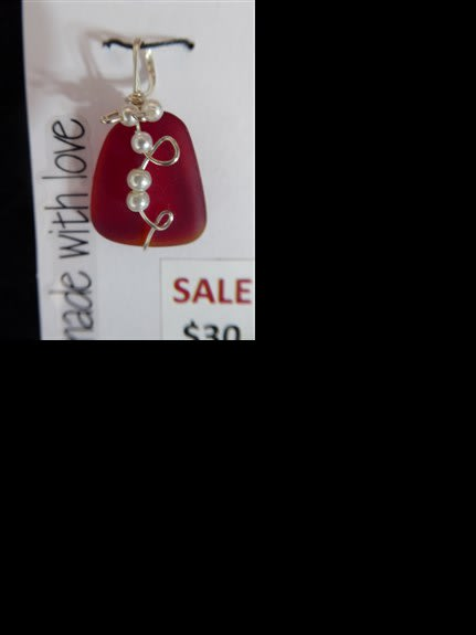 Red sea glass pendant with pearls wire wrapped on it.
