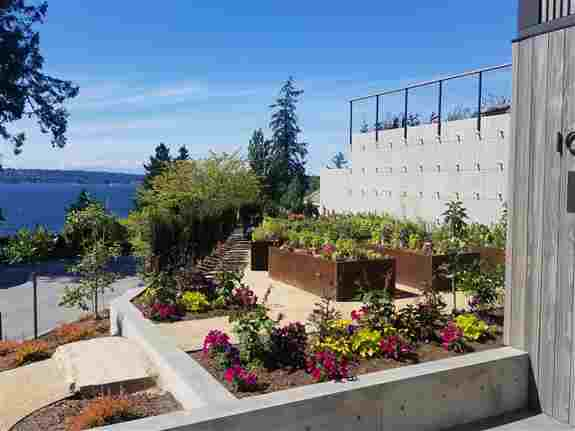 A functional gardening space with these beautiful Corten steel planters are a perfect place to spend time enjoying this incredible Pacific NW view.