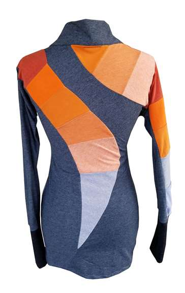 This is a one of kind tunic top, made from 100% upcycled t-shirts. It has a cowl-neck, and is a fully asymmetric design. The front tunic has a side panel of gradient color. The back has an incredible slice of color gradient, and one sleeve has a connected