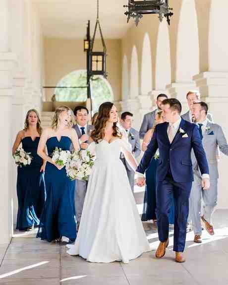 Navy blue groom suit with light grey groomsmen suits available for rental or purchase.