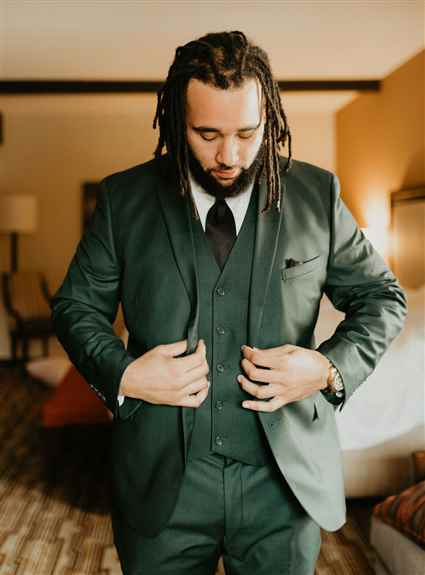 Forest green three piece suit available for purchase.
