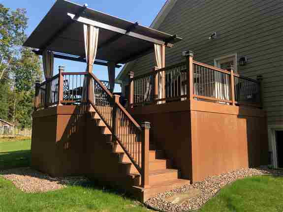 Motorized Pergola / Awning with side privacy curtains<br />over PVC maintenance friendly deck
