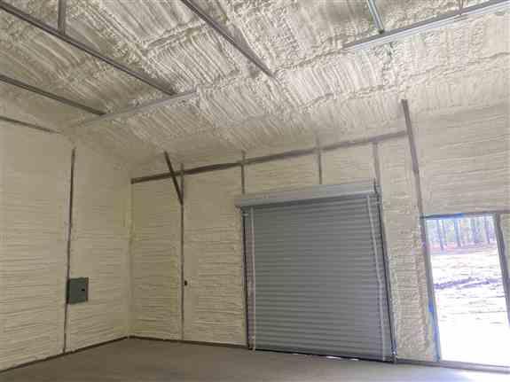 "Metal Building with 2 1/2"" tube steel framing."