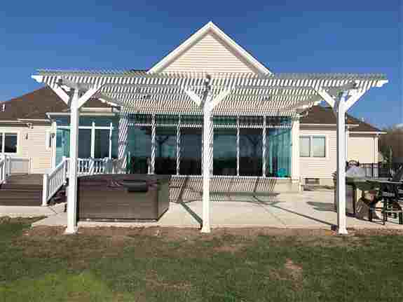 Motorized Pergola / Awning over concrete patio which allows you sun, shade and light to interior rooms