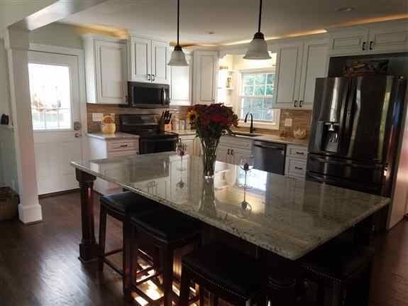 Kitchen removing a load bearing wall. Under and over cabinet LED lighting.  Large Island.