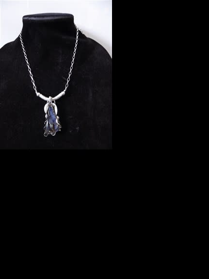 WOW! This is a large piece of Australian OPAL. It's designed in a silver clam setting with a gorgeous silver necklace.