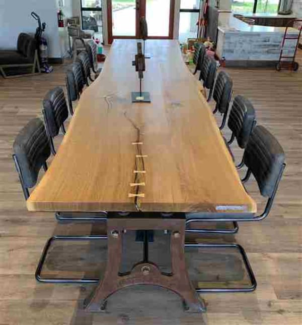 Urban salvaged white oak live edge table combined with our Version 1 hand-poured cast iron vintage industrial legs.