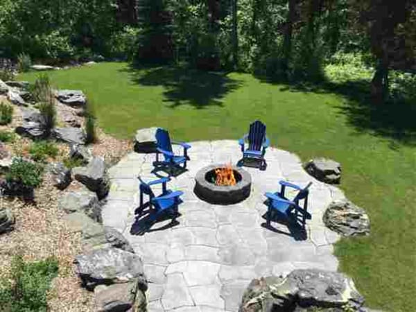 Grand Flagstone patio and fire pit area at beautiful cabin property near Kenora.