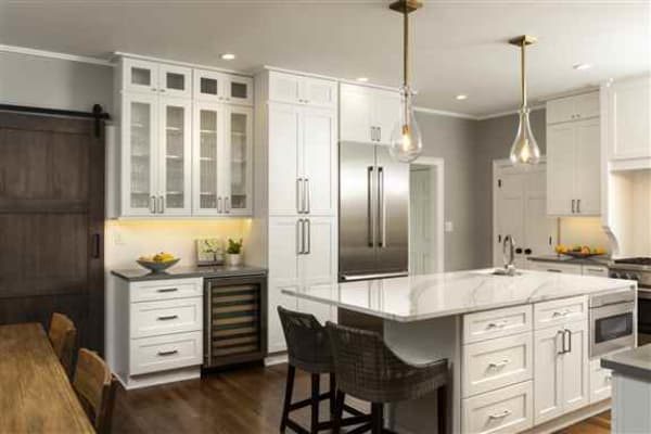 Shaker Style kitchen with dry bar and floating island.