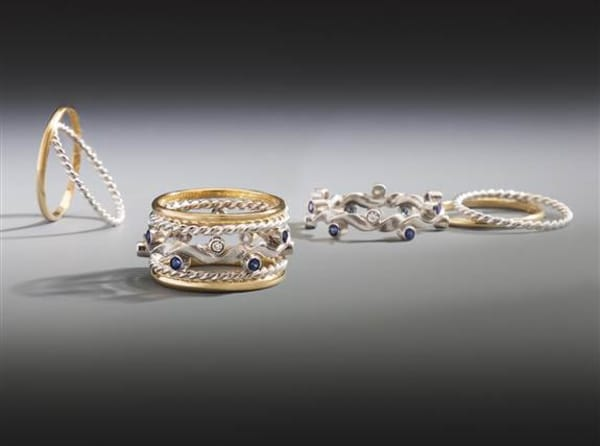 These five rings combine into an elegant symmetrical stack. The centerpiece is sculpted in FAIRMINED silver set with Montana sapphires and recycled diamonds. The outside rings are hand-forged in FAIRMINED silver and 18k FAIRMINED gold.<br /><br />