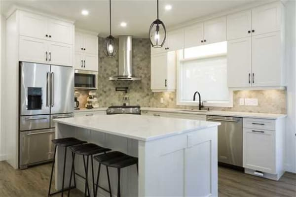 This kitchen features a custom hand-brushed finish on maple cabinets.
