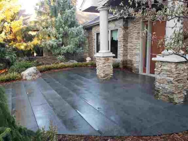Unique patio installation utilizing 6 foot long bluestone panels. Wonderful application in a large entry situation.