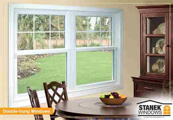 Colonial grids add a designer touch to white double-hung windows.