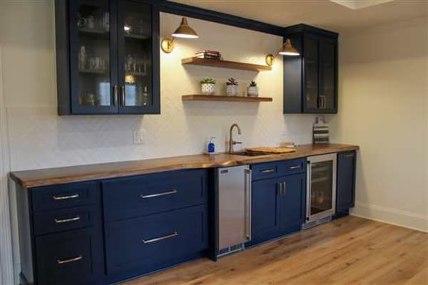 Fully remodeled kitchen including handcrafted brick backsplash.