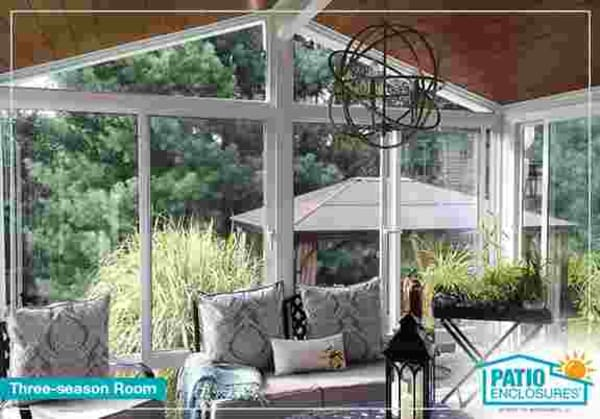 Enjoy your backyard spring through fall in a Patio Enclosures three-season room.