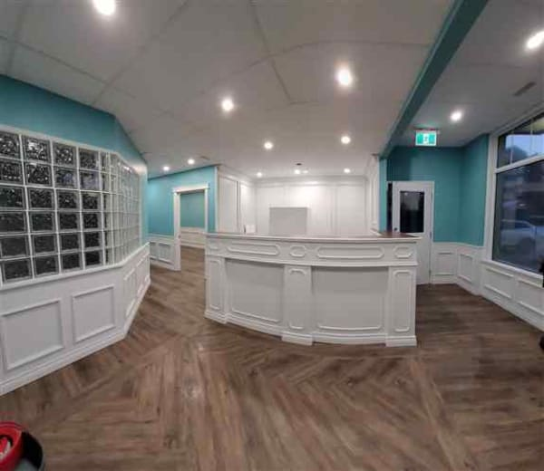 NHance refinished this beautiful reception area & boardroom from a dark wood oak to a Fleur de Sel tone. Finished using our UV light on Satin sheen.