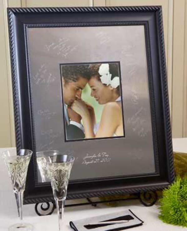 This Signature Keepsakes Elegant Frame comes complete with one Signature Scribe, one cleaning cloth and one Guest Instruction card.  This black wood frame is a perfect choice for any sophisticated traditional room. All of our frames can be displayed horiz
