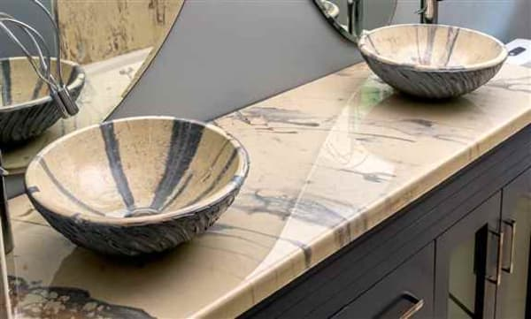 We covered glass bowls to match the countertop!