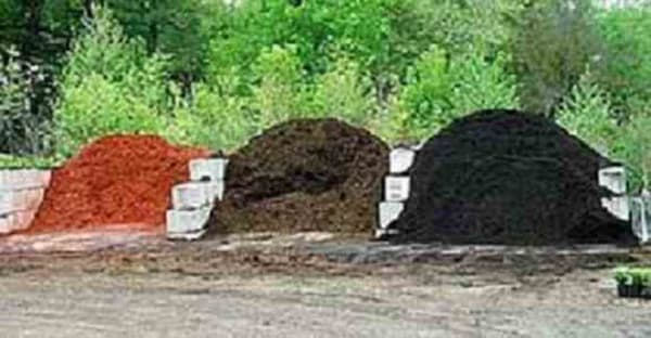 Piles of our Red, Brown and Black Triple Shredded Hardwood Mulches