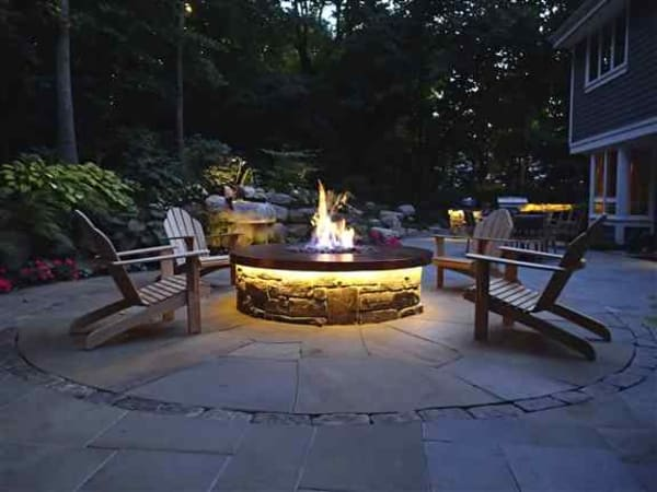 Orono Residence, LED Strip Lighting under Firepit and Outdoor Kitchen overhang, Uplighting, Down Lighting and Area/Walkway Lighting in Backyard.