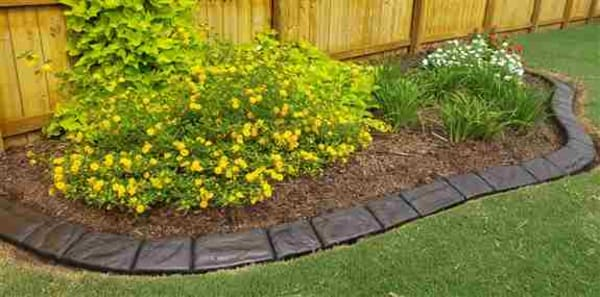 Define an existing landscape bed with a decorative border.