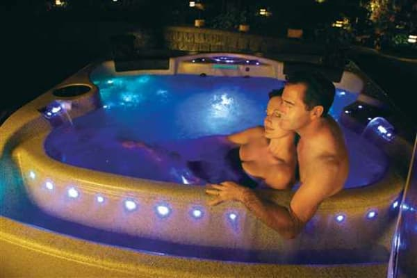 A hot tub is the perfect place to unwind and relax at the end of the day.  Amazing lighting packages enhance your relaxation experience.
