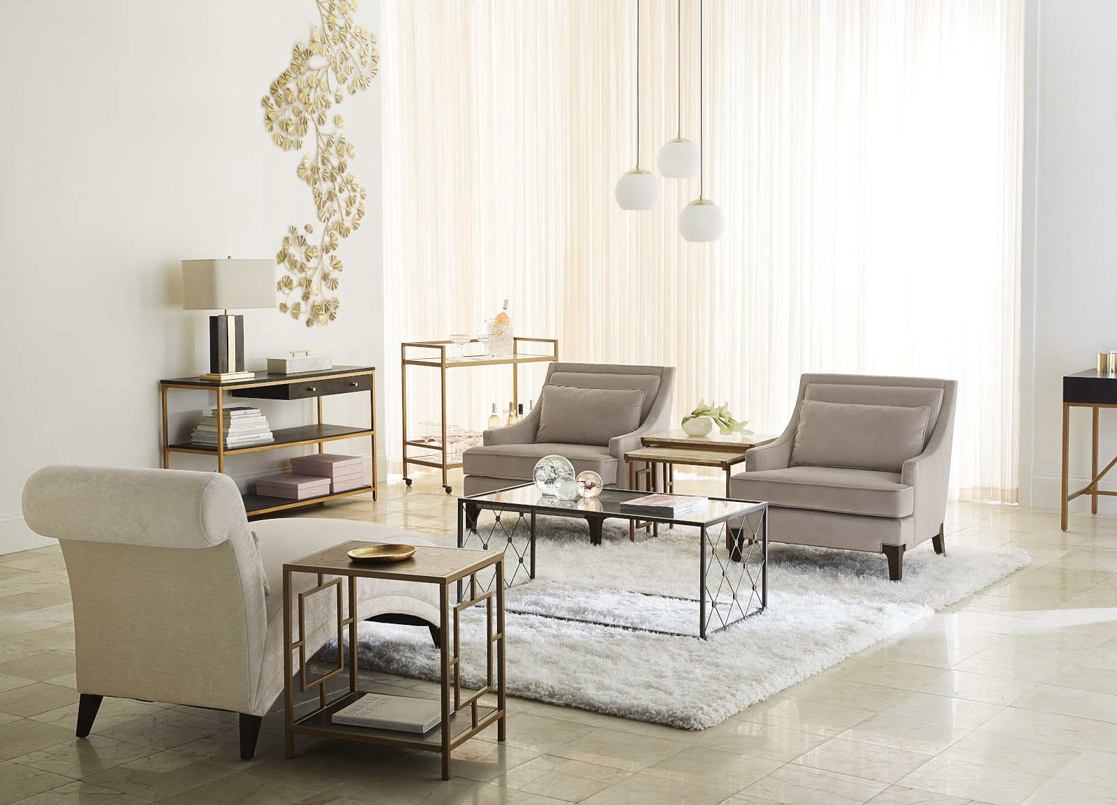 Modern living room with white, gold and grey furniture