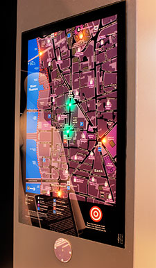 Backlit touchscreen mounted on a wall