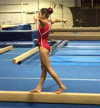 Gymnast practicing on balance beam
