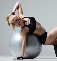 Woman performing exercise with ball