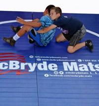 Wrestlers on wrestling mat