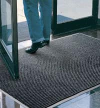 Person walking through doorway on entry mat