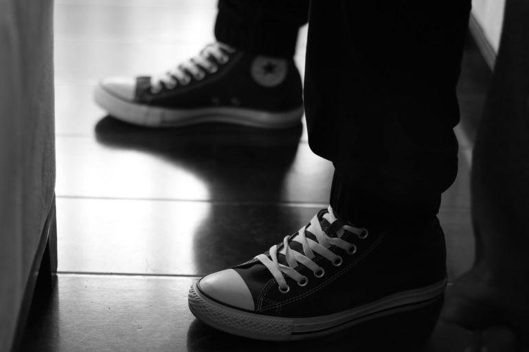Schwarz-weiße Converse All Stars}