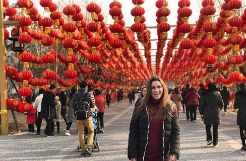 Student standing in front of lanterns_s8Sp2a2w