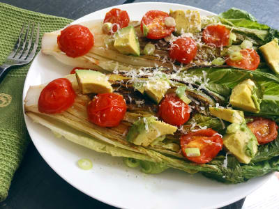 Grilled Lettuce with Avocado, Blistered Tomatoes, and Parm