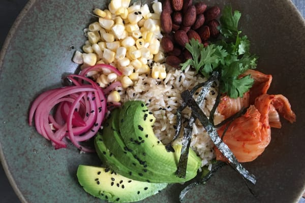 Brown Rice Bowl with Avocado, Pickled Red Onions, and Lemon-Tahini Dressing