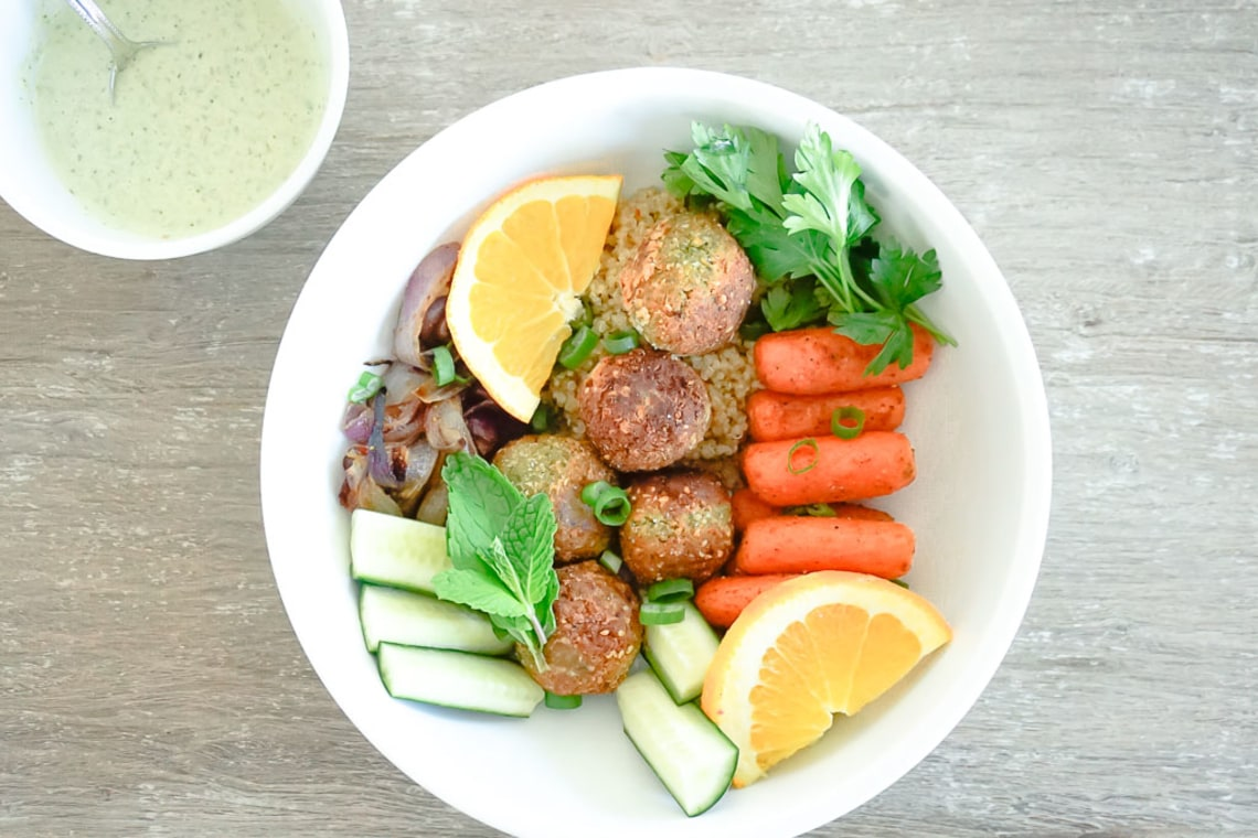 Falafel and Roasted Vegetable Buddha Bowls with Toasted Pumpkin Seed Yogurt Sauce
