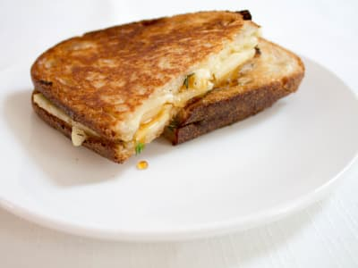 Image forGrilled Brie, Apple, and Hot Honey Sandwich