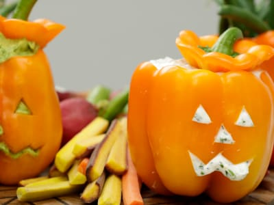 Image forBell Pepper Jack-o-Lanterns with Avocado and Herb-Yogurt Dips