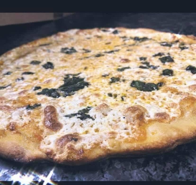 Photo of Famous Traditional Pizza